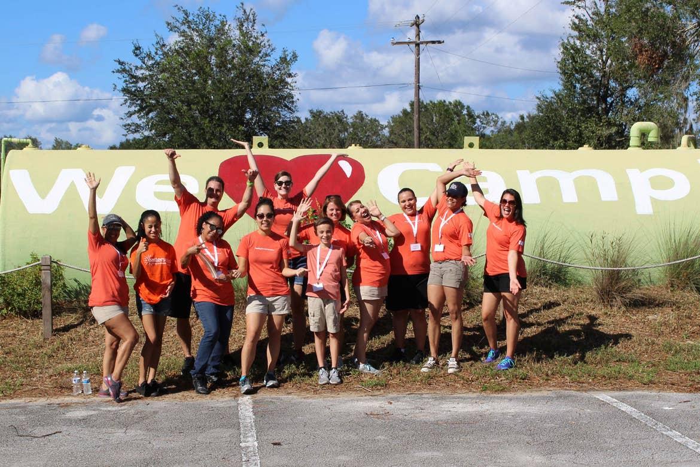 HICV Volunteers in front of a 'We Love Camp!' tank at easterseals.