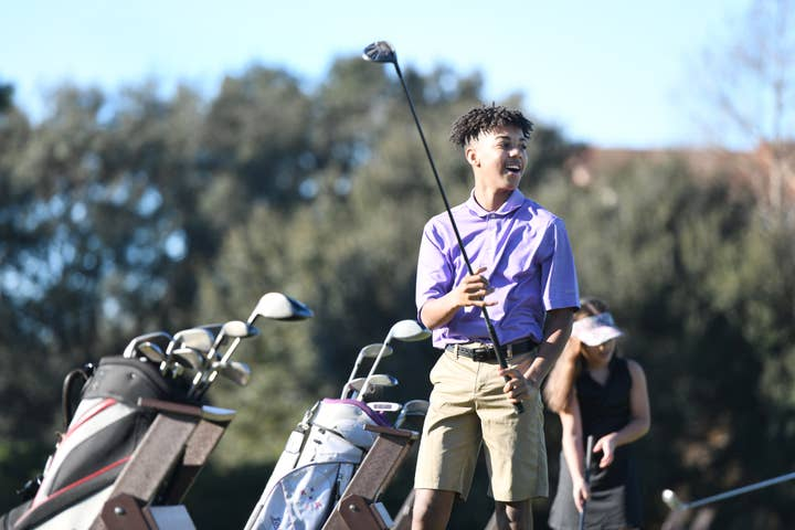 Young golfer preparing to swing at Orange Lake Resort near Orlando, Florida