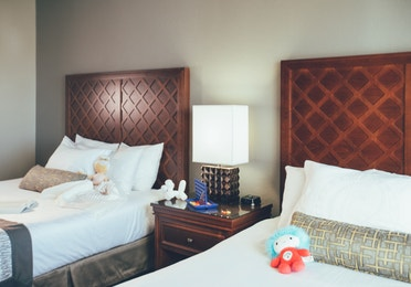 Bedroom with two beds in a Signature villa in River Island at Orange Lake Resort near Orlando, Florida