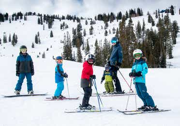 Featured Contributor, Jessica Averett's family, adorn with ski gear, make their way down the snowy slopes.