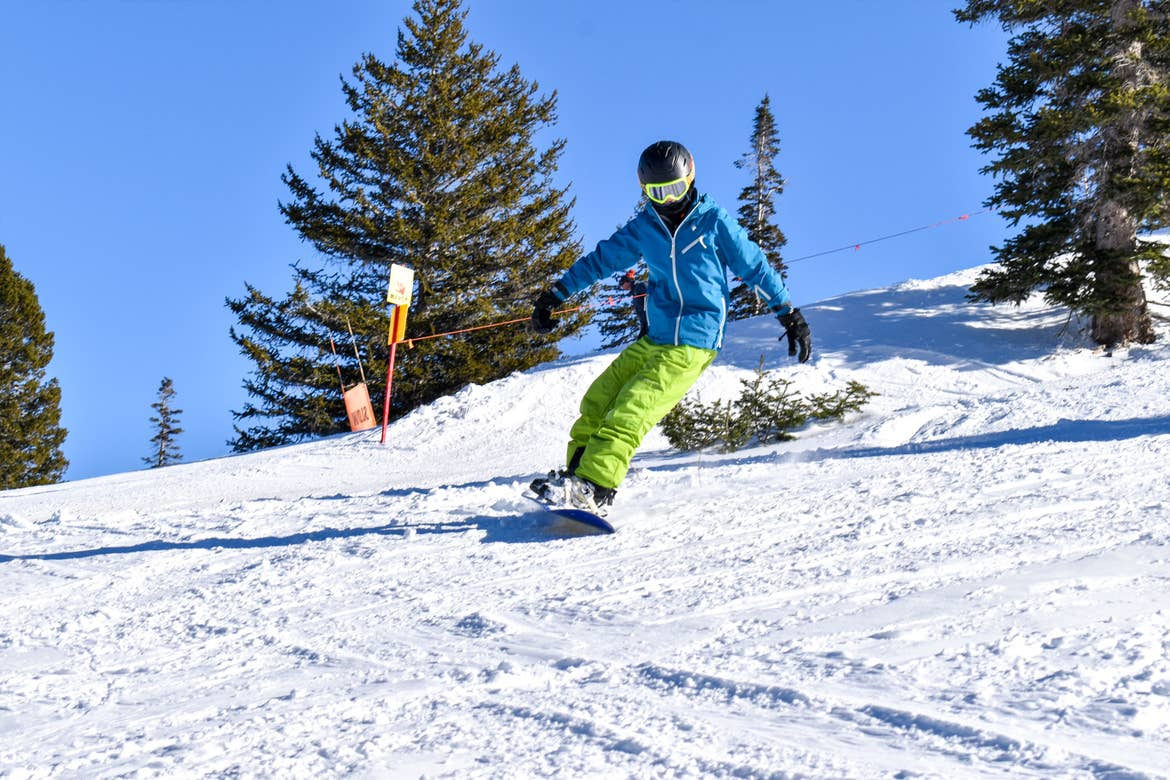 Contributor, Jessica Averett's daughter clad in winter and skiing gear ascends down the slopes.