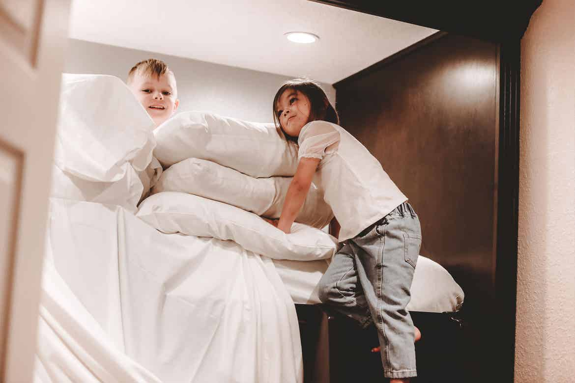 Featured contributor, Mia St. Clair's daughter and nephew make a pillow fort in the bunk bed in their villa at Orange Lake Resort in Orlando, FL.