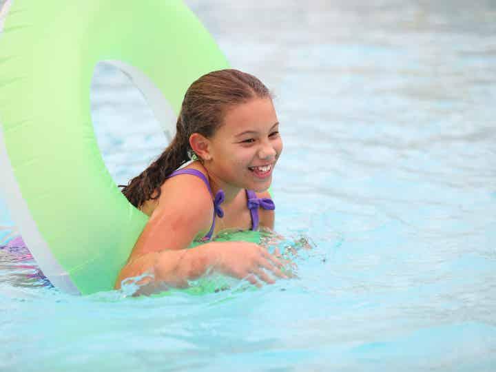 Child floating in tube at Orange Lake Resort near Orlando, Florida.