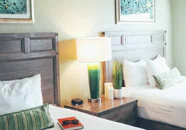 Two beds and a nightstand in a villa in River Island at Orange Lake Resort near Orlando, Florida