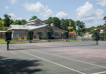 Outdoor tennis court at Villages Resort in Flint, Texas