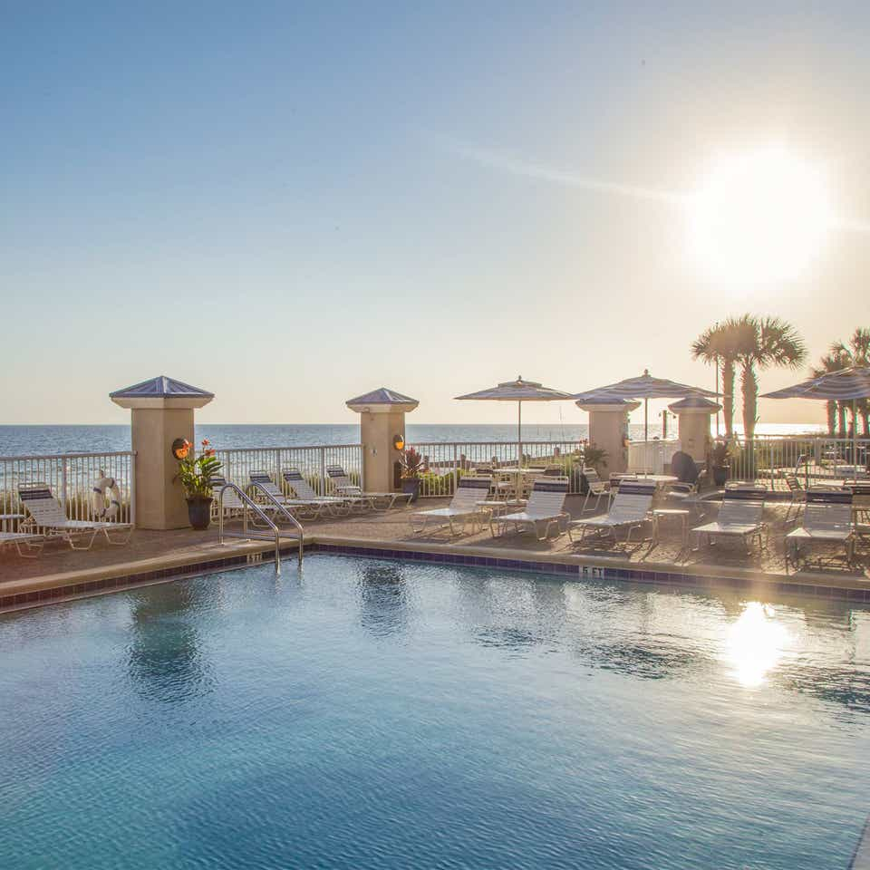 Outdoor pool with beach view at Panama City Beach Resort in Florida.