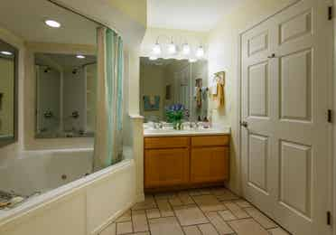 Bathroom with garden tub in a two-bedroom presidential villa at the Holiday Hills Resort in Branson Missouri.