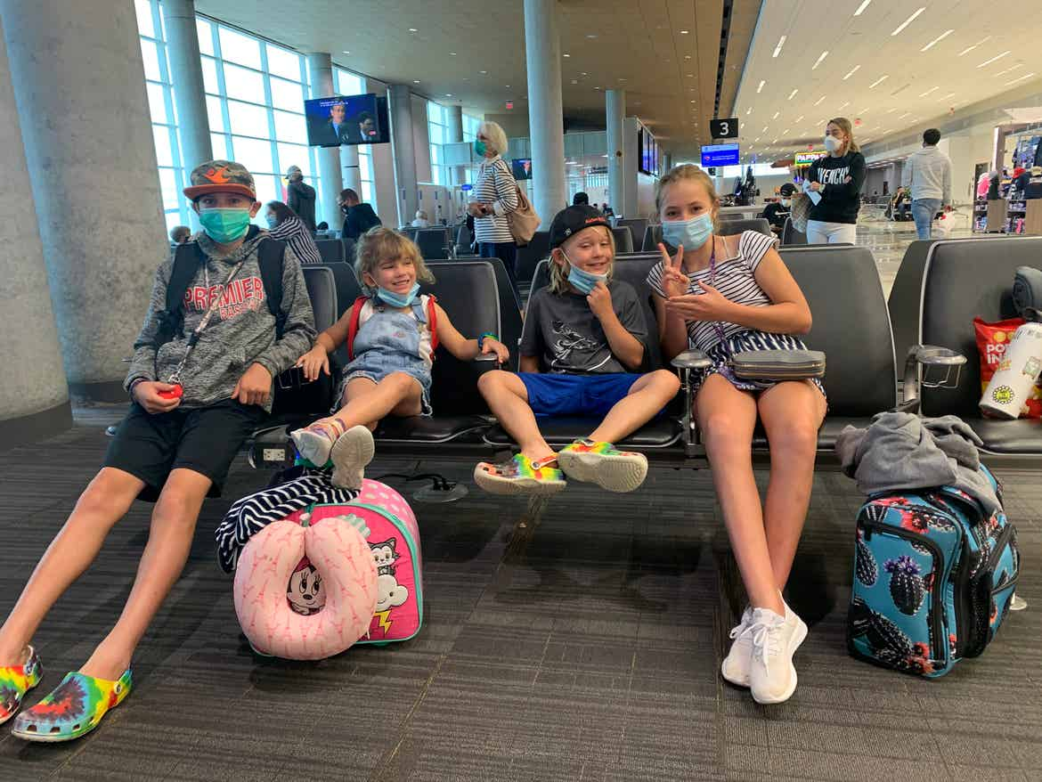 Ashley's kids posing in the airport terminal.