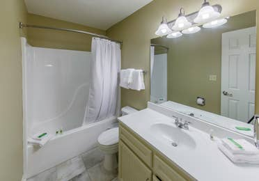 Bathroom with shower tub and sink in a three-bedroom ambassador villa at the Hill Country Resort in Canyon Lake, Texas.
