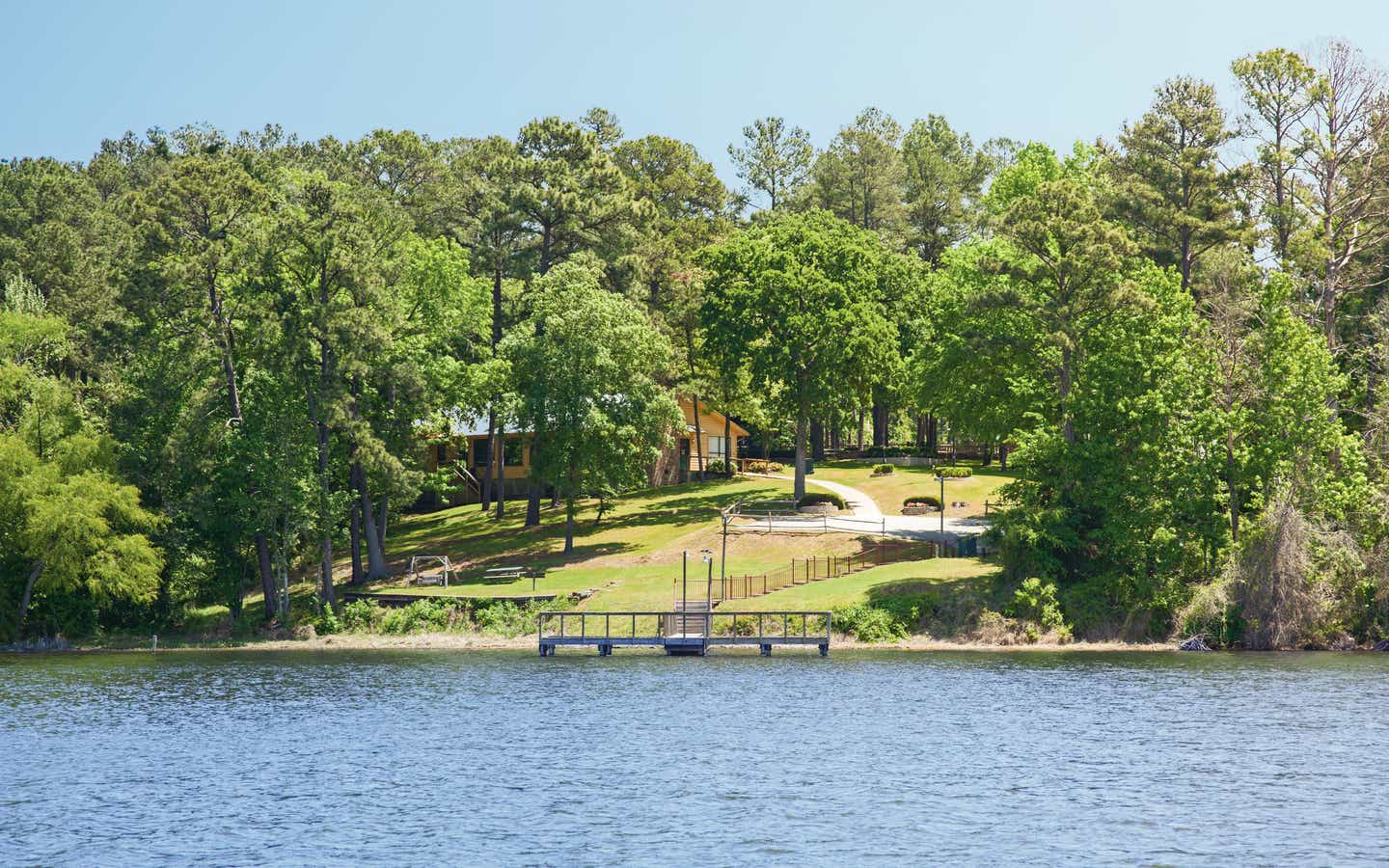 Lake view property with dock and villa at the Lake O' the Wood Resort in Flint Texas.