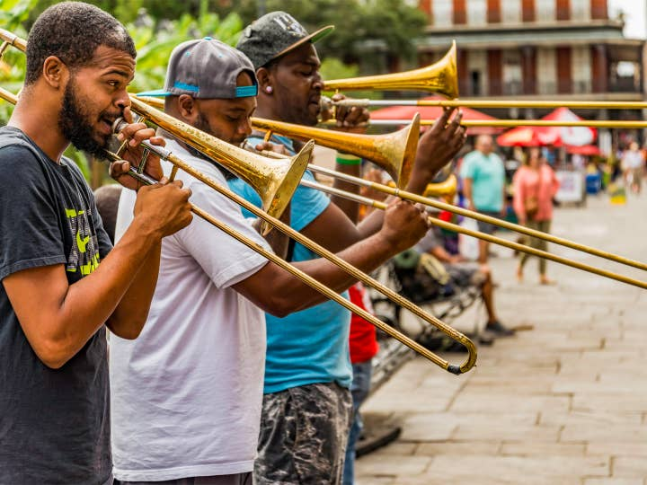 Group of people playing jazz instruments near New Orleans Resort.