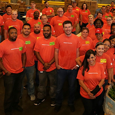 Holiday Inn Club Incorporated employees volunteering at Second Harvest Food Bank