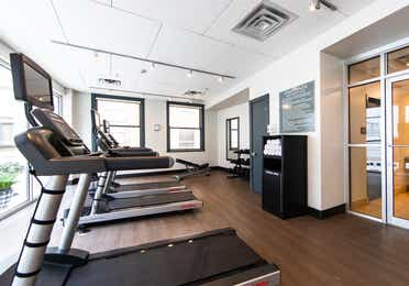 Fitness center with treadmills, free weights and towels at New Orleans Resort in Louisiana.