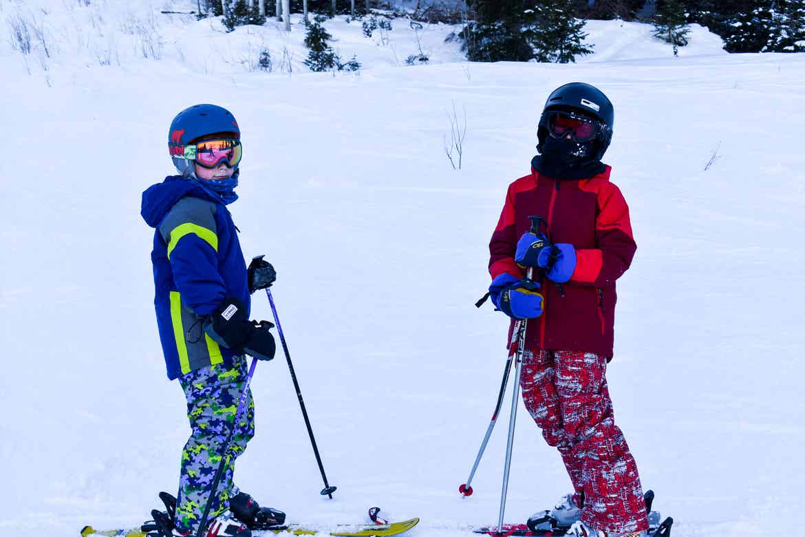 Featured Contributor, Jessica Averett's children wear ski gear on the slopes.