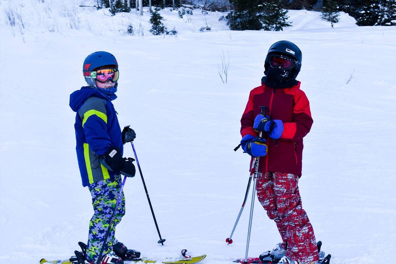 Featured Contributor, Jessica Averett's children wear ski gear on the slopes.