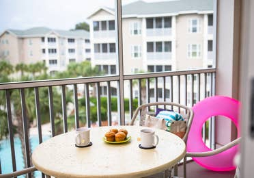 Balcony with outdoor furniture in a two-bedroom villa at South Beach Resort in Myrtle Beach, South Carolina.