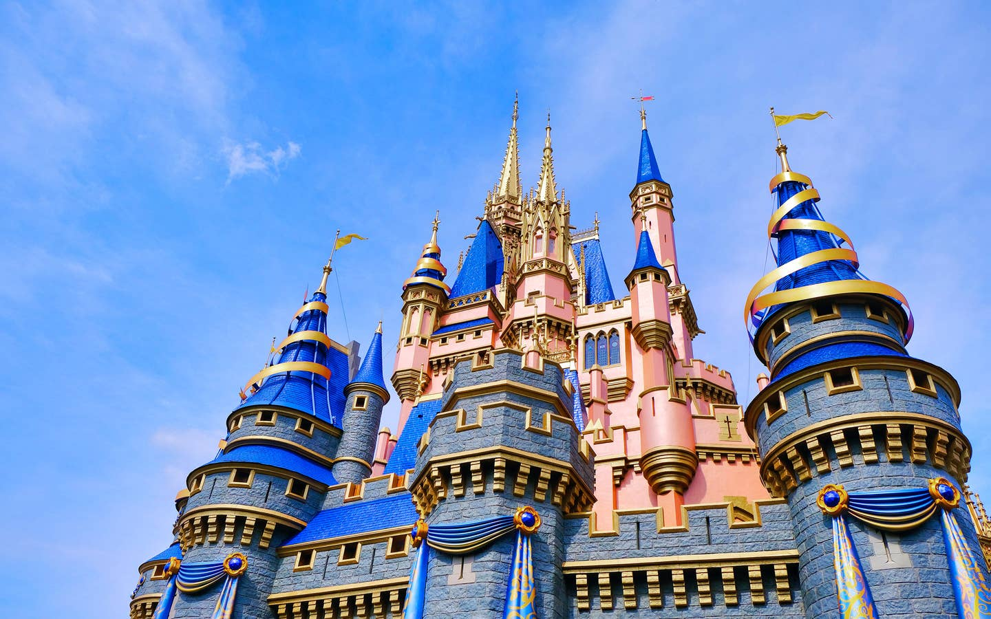 Cinderella's Castle at Magic Kingdom in Walt Disney World Resort is decorated in gold and blue ribbons for it's upcoming 50th Anniversary.