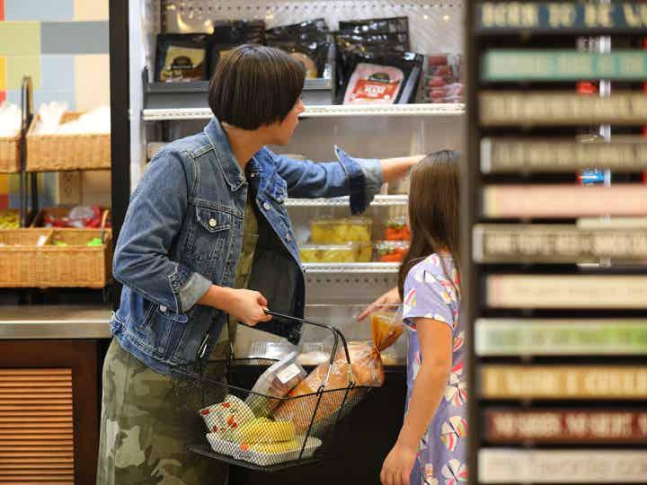Adult and child shopping in Marketplace at Orange Lake Resort near Orlando, Florida.