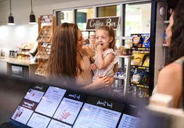 Mom and child visiting the Cafe at Orange Lake Resort near Orlando, Florida