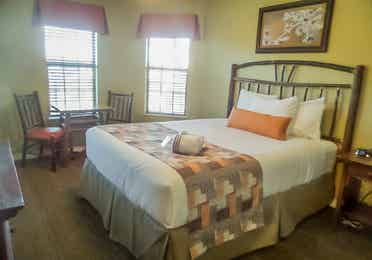 Bedroom with sitting area in a two-bedroom villa at the Holiday Hills Resort in Branson Missouri.