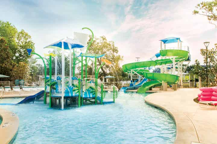 Waterslide and play area at Splash Cove at South Beach Resort