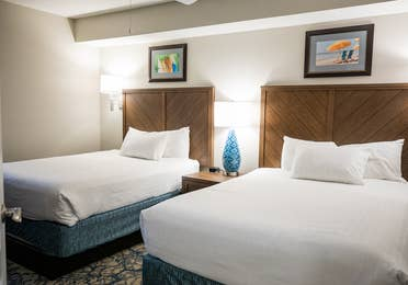 Bedroom with two beds in a two-bedroom villa at Cape Canaveral Beach Resort.