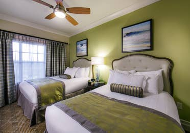 Guest bedroom with two beds in a Signature Collection villa at South Beach Resort