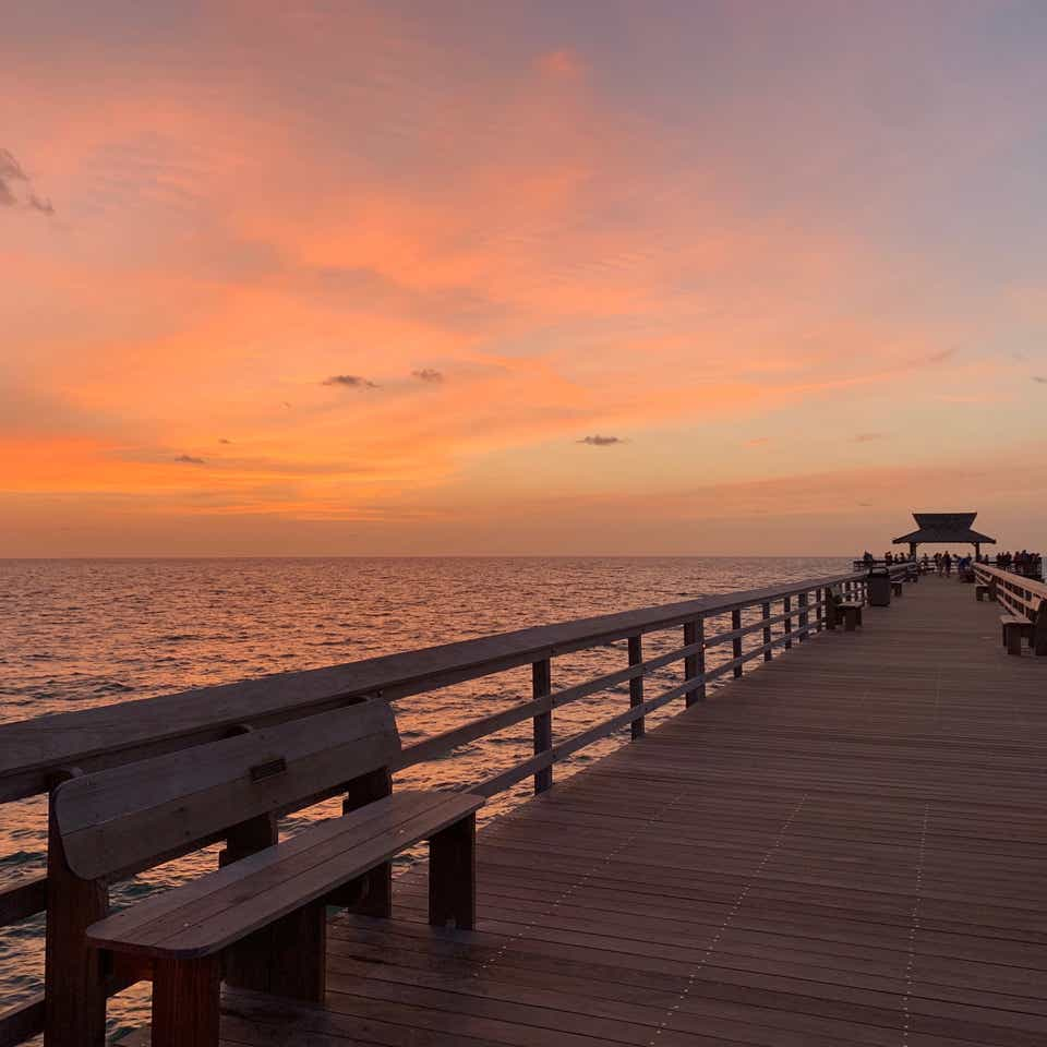 A beautiful view of the colorful sunset from the pier on Marco Island, Florida.