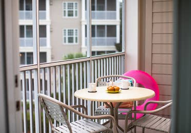 Balcony with outdoor table and chairs in a two-bedroom villa at South Beach Resort in Myrtle Beach, South Carolina.