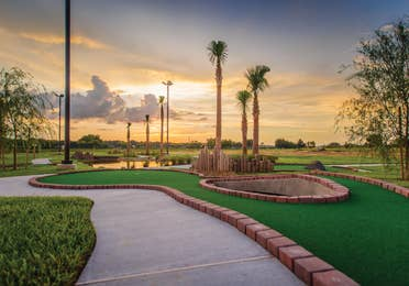 Outdoor mini golf course at sunset at Orlando Breeze Resort in Florida.