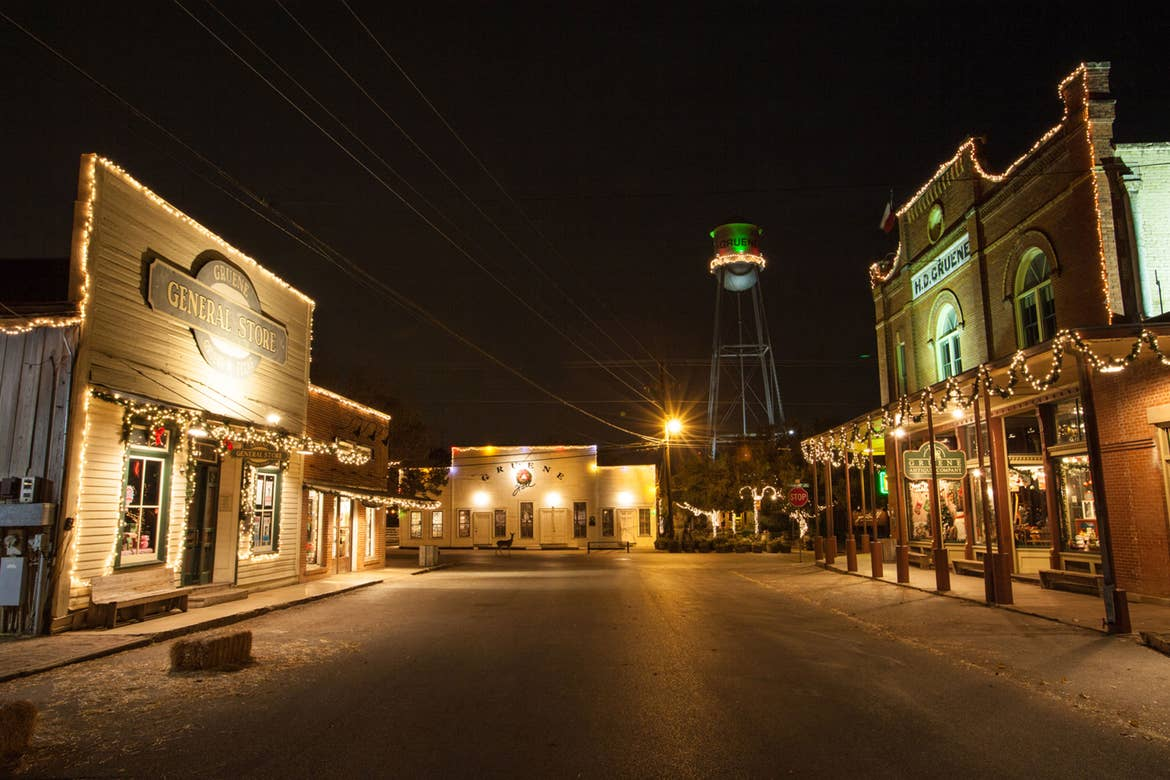 The Gruene Christmas Market days town square decked with Christmas lights.