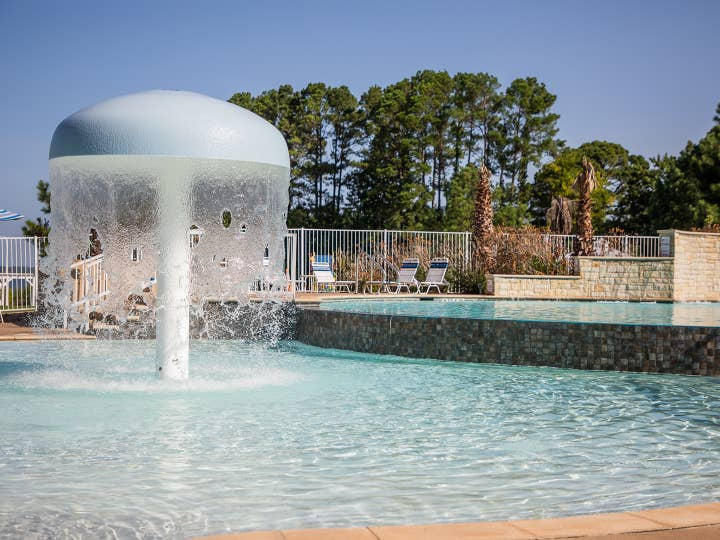 Shower umbrella in outdoor Beach Club pool at Villages Resort in Flint, Texas