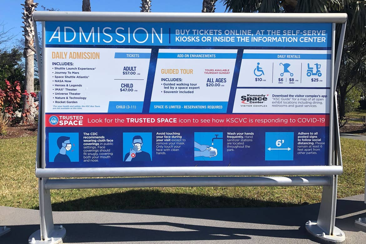 A sign with information about Admission and CDC Safety Guidleines at the Kennedy Space Center in Cape Canaveral, Florida.
