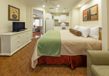Lock-off bedroom with kitchenette and flat screen TV in a presidential villa at Fox River Resort in Sheridan, Illinois