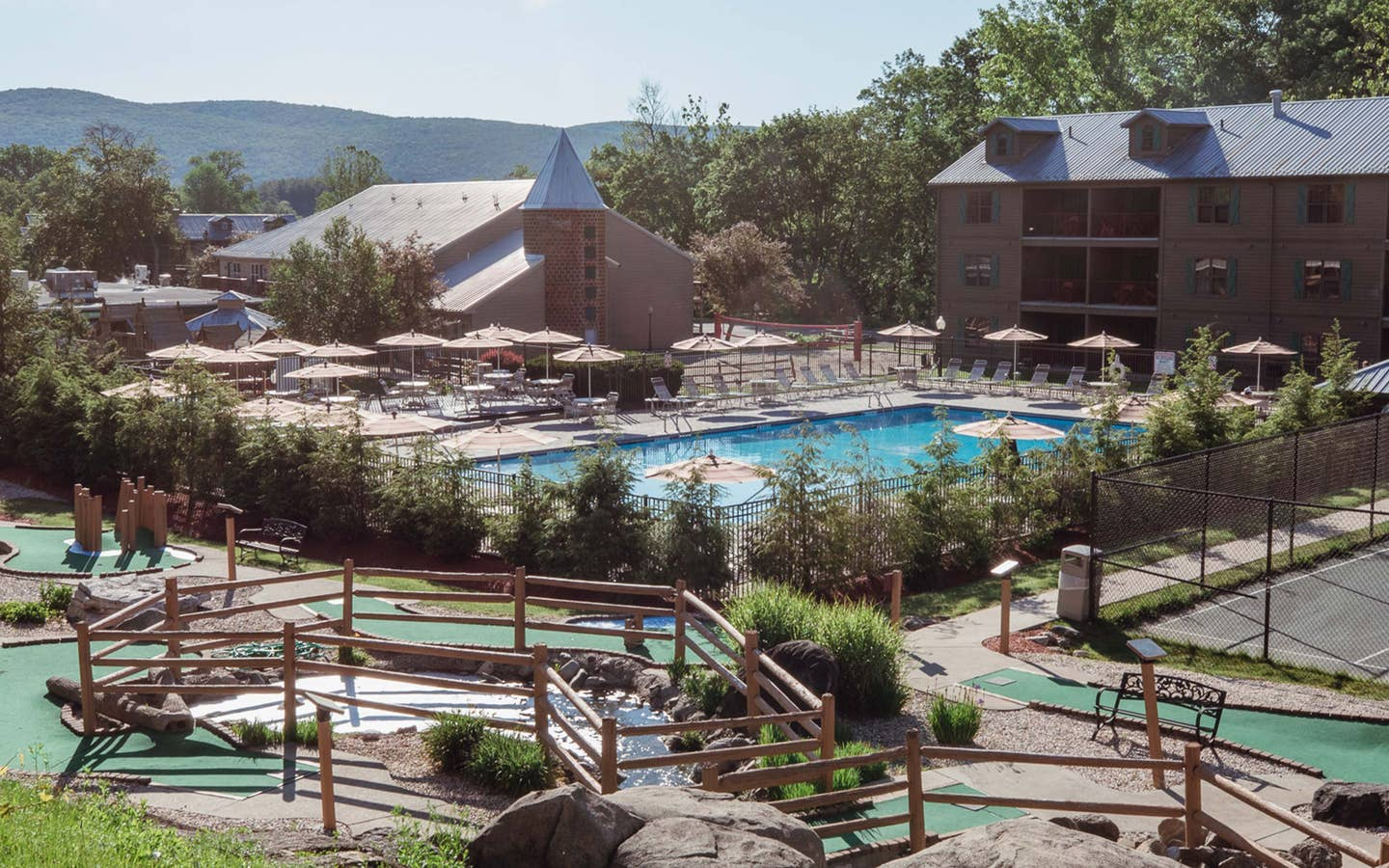 Property shot of Oak n' Spruce Resort with an outdoor pool, mini golf course and property building in South Lee, Massachusetts.