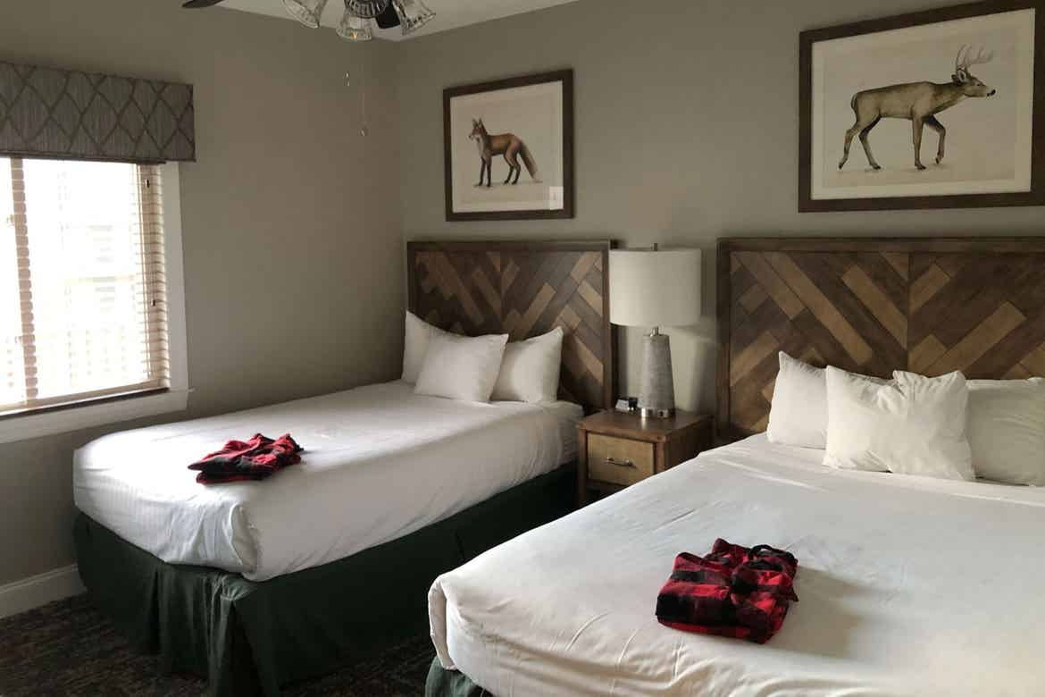 Two twin-sized beds at our Smokey Mountain resort Two-Bedroom villa.