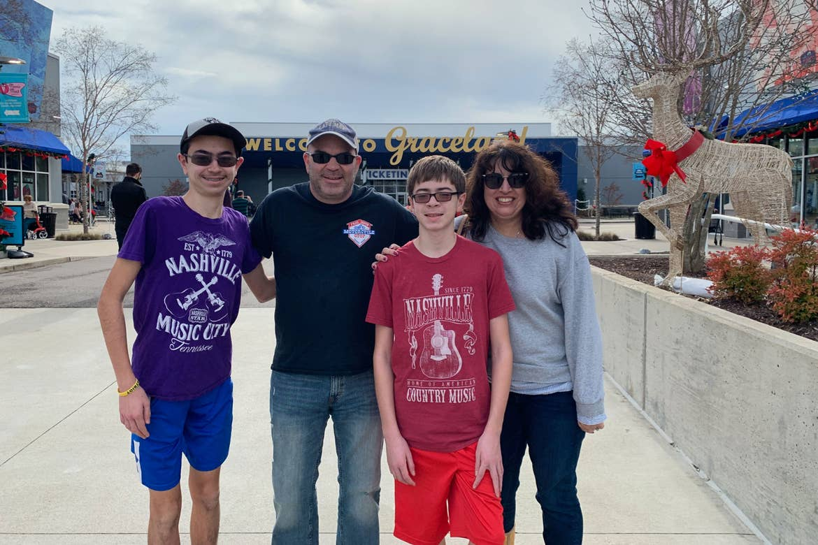 Jennifer (right) and her family stand outside of the Graceland Visitors center with Christmas Decorations.