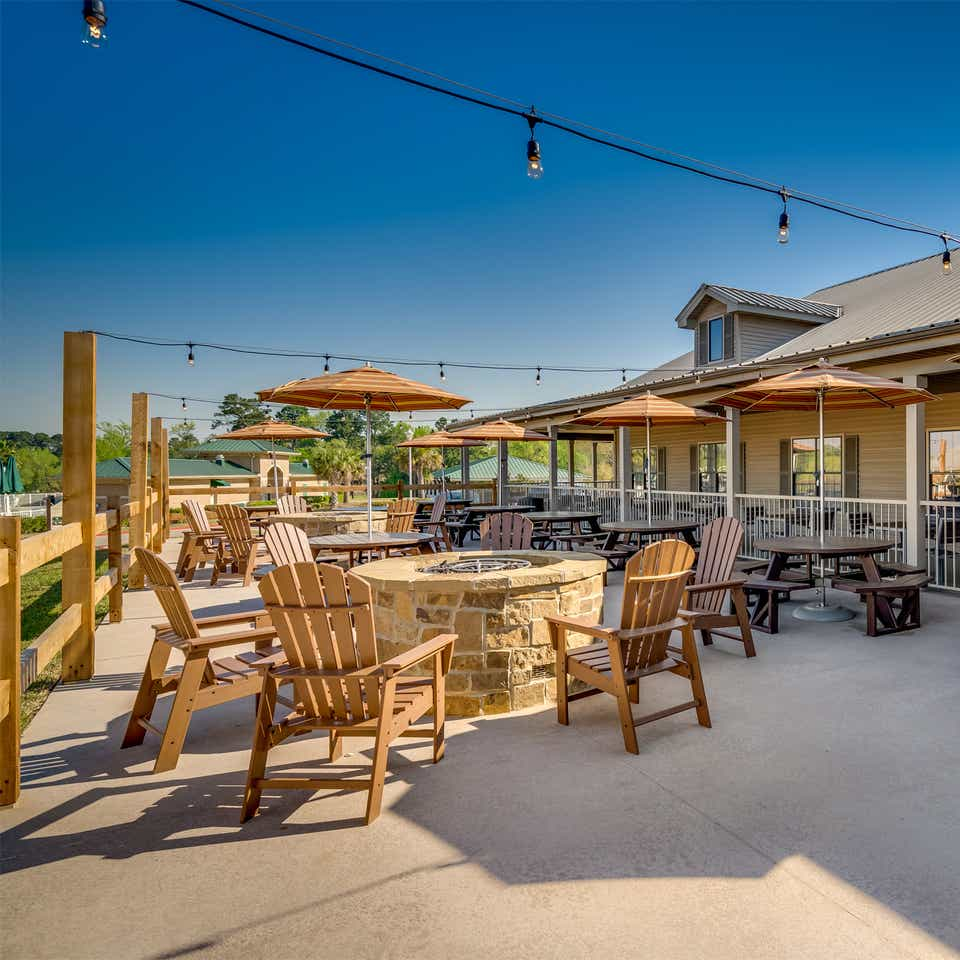 Firepit and outdoor seating at Piney Shores Resort in Conroe, Texas.