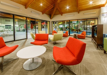 Indoor area with modern seating and large glass doors looking out at the pool at Scottsdale Resort in Arizona
