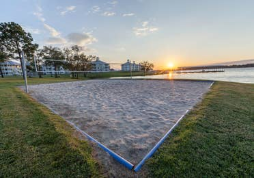 Outdoor sand volleyball court at Piney Shores Resort in Conroe, Texas