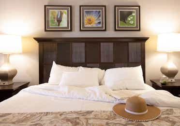Closeup of sun hat sitting on bed in a villa in East Village at Orange Lake Resort near Orlando, Florida