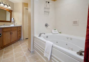 Bathroom with a shower/tub combination at Smoky Mountain Resort in Gatlinburg, Tennessee.