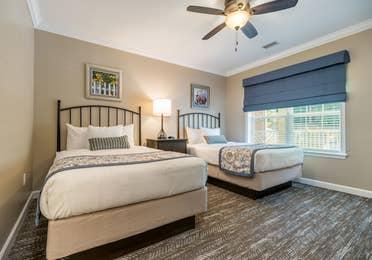 Guest bedroom in a two-bedroom villa at Williamsburg Resort