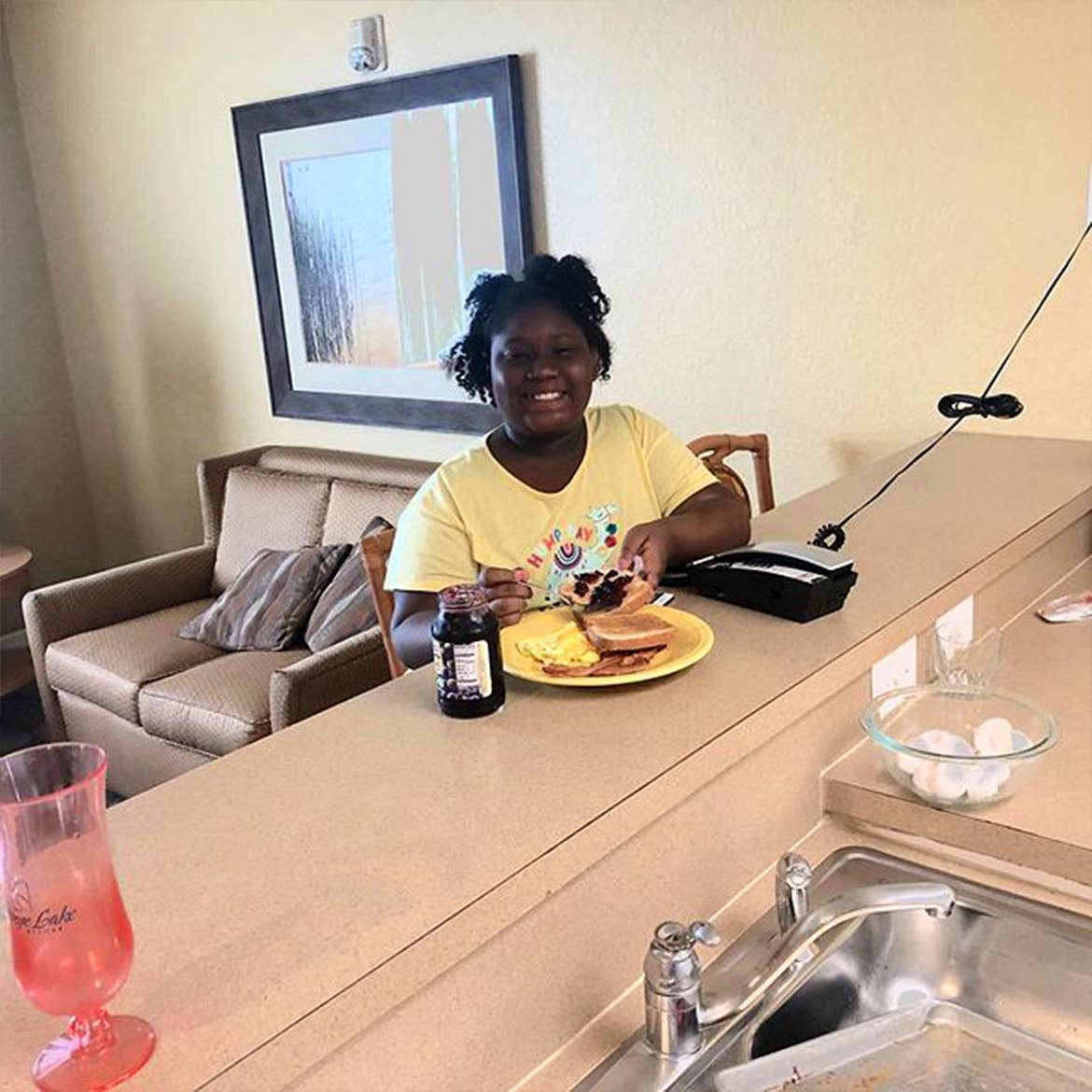 A guest enjoying breakfast at their kitchen countertop in our villa at Orange Lake Resort.