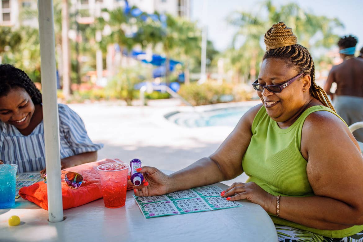 Krystin Godfrey (left) and her aunt (right) enjoy a round of bingo poolside in River Island at our Orange Lake Resort located in Orlando, FL.
