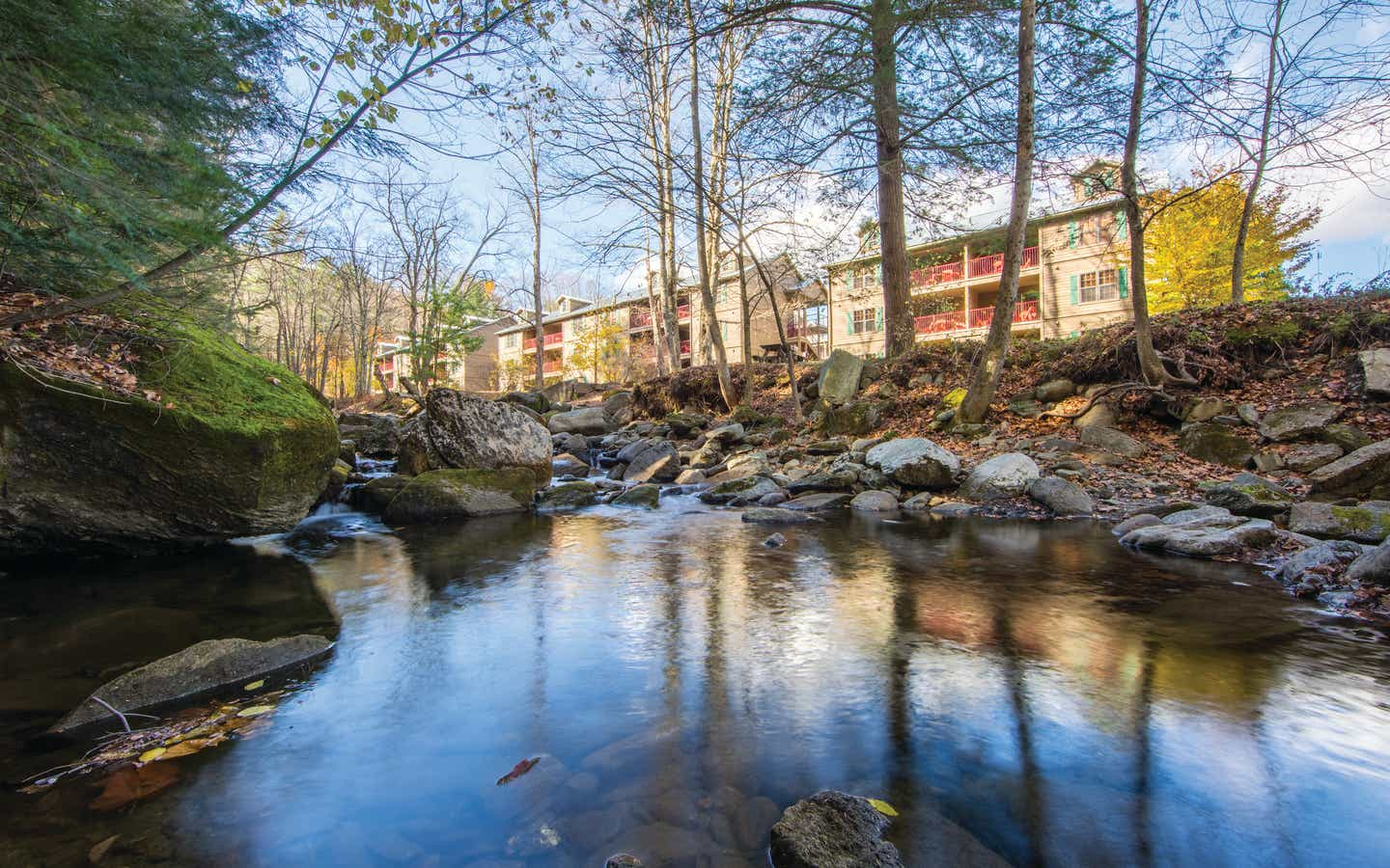 A creek lined with trees and running along the Oak n' Spruce Resort in South Lee, Massachusetts