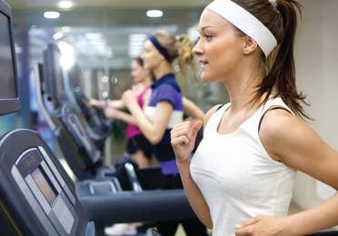 Group fitness running on treadmills