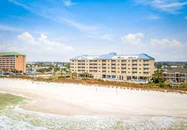 View of property building, ocean, and beach at Panama City Beach Resort