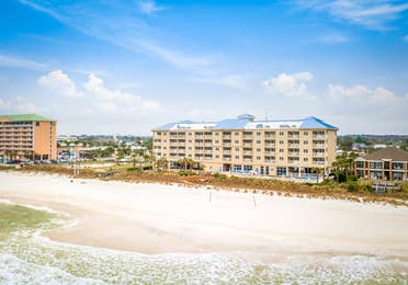 View of property building, ocean, and beach at Panama City Beach Resort.