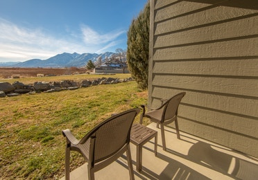 Patio with a view of the Sierra Nevada Mountains outside of a one-bedroom villa at David Walley's Resort in Genoa, Nevada